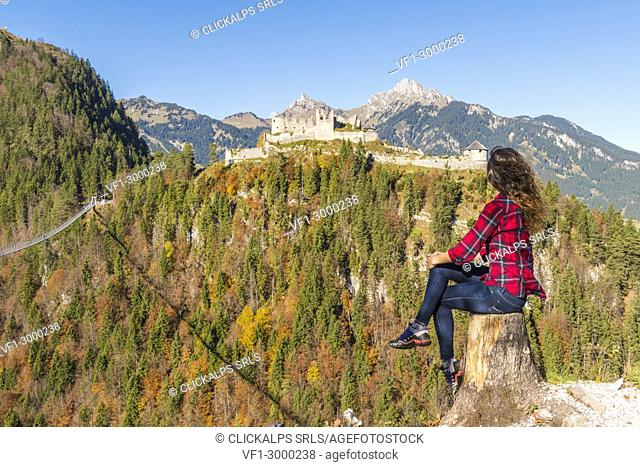 Reutte, Tyrol, Austria, Europe. Ehrenberg Castle and the Highline 179, the world's longest pedestrian suspension bridge. A young woman admiring the view