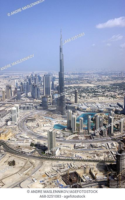 Helicopter view of Burj Khalifa tower in Dubai. . Under contruction 2009.