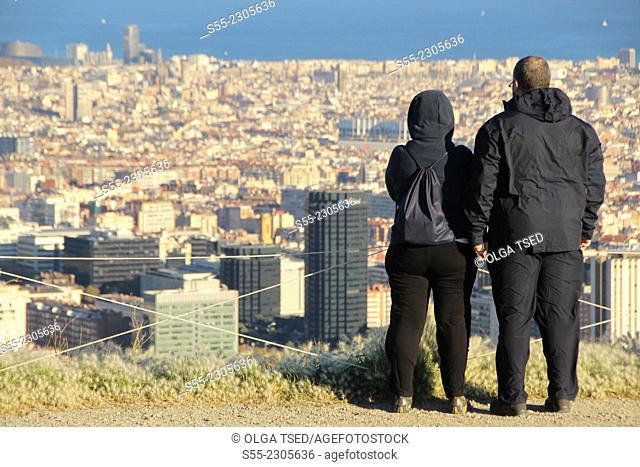 A man and a woman watching Barcelona from Collserola mountain, Barcelona, Catalonia, Spain