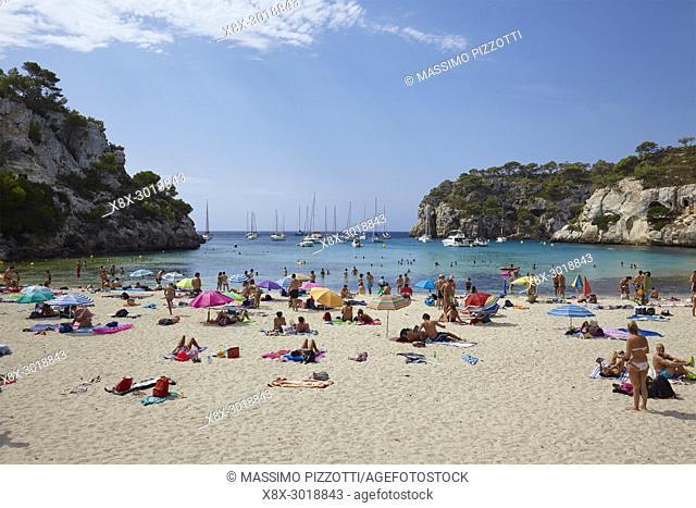 Tourists tanning in Cala Macarella in Menorca,Balearic Islands, Spain
