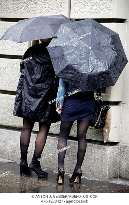 Women with umbrella at the Bancomat , zurich switzerland