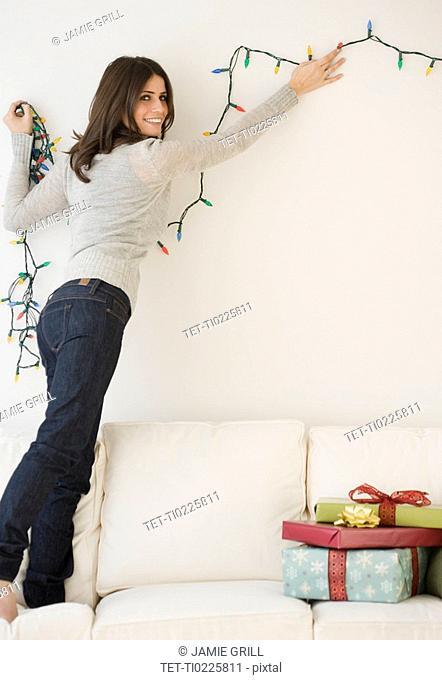 Woman hanging Christmas lights