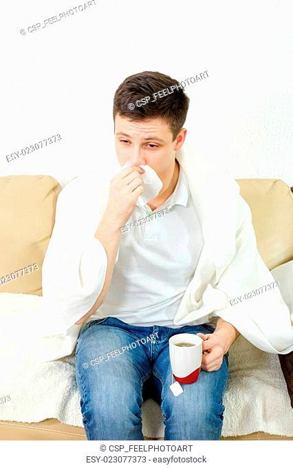 Young adult man feeling sick