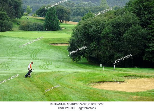 Golfer on green street. Larrabea golf course, Alava, Basque Country, Spain