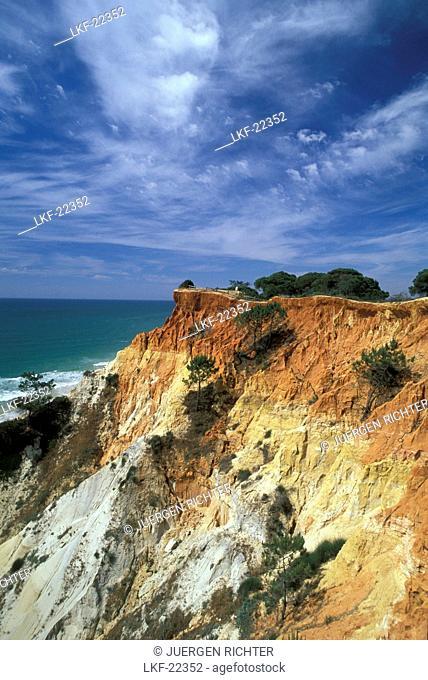 Praia da Falesia, rocky coast under clouded sky, Algarve, Portugal, Europe