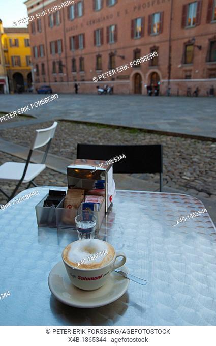 Cup of cappuccino coffee at Piazza xx Settembre square Modena city Emilia-Romagna region central Italy Europe