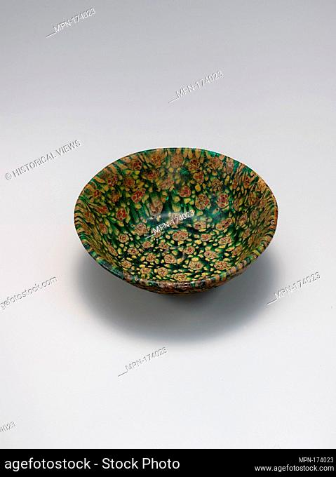 Glass Bowl in Millefiori Technique. Object Name: Bowl; Date: 9th century; Geography: Made in Probably Iraq; Medium: Glass, green, opaque yellow