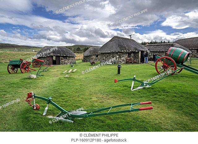Tourists visiting thatched cottages at the Skye Museum of Island Life, Kilmuir, Isle of Skye, Scotland