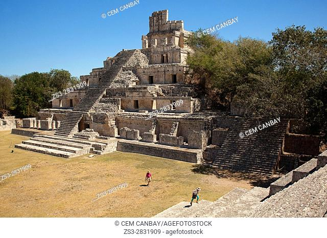 Visitors in front of the Edificio de los Cinco Pisos building at Gran Acropolis in Edzna Mayan Archeological site, Campeche State, Mexico, Central America