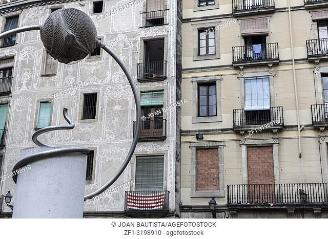 George Orwell square in gothic quarter of Barcelona. Facade houses and sculpture reproduction of one work of surreal sculptor Leandre Cristofol