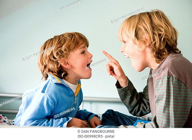Two young boys quarrelling