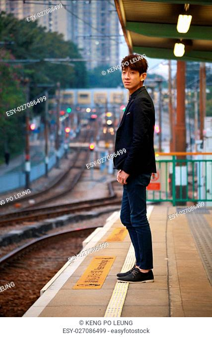 Asia man waiting train at outdoor