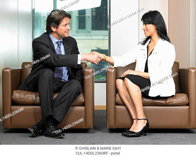 Business man and woman shaking hands