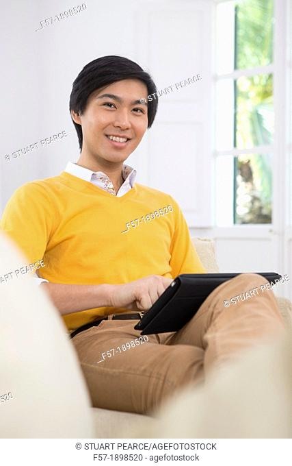 Young Asian businessman using his Tablet computer