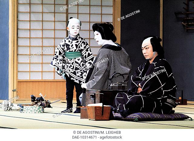 Actors with a child during a Kabuki theatre performance, Japan