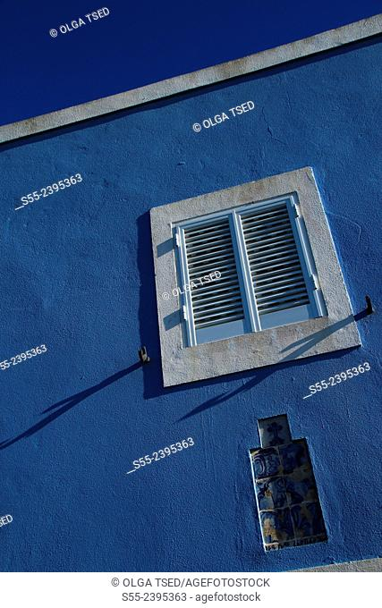 Blue house and a shuttered window. Candelaria village, Sao Miguel island, Azores, Portugal
