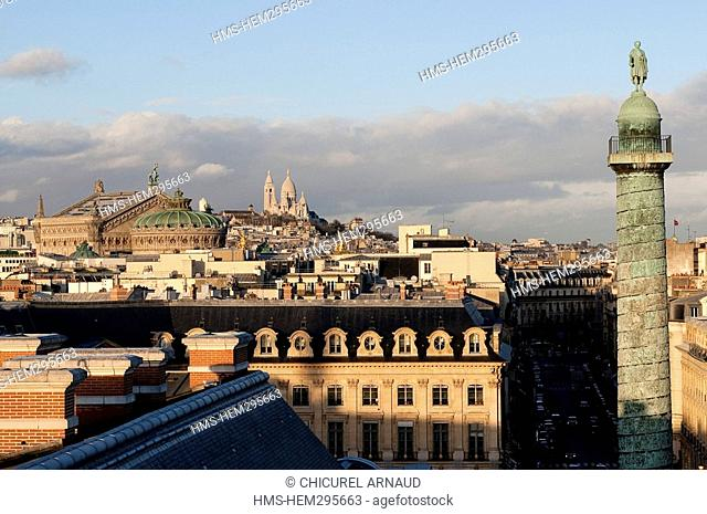 France, Paris, the column of Vendome square from the roofs with the Sacré-Coeur and Garnier opera house in the background