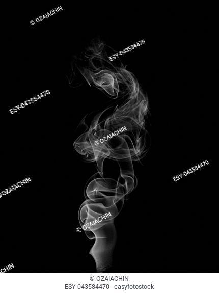 Tobacco smoke. On a black background