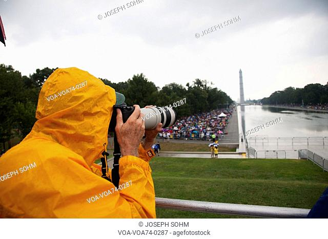 Photographer Joseph Sohm with Canon zoom lens takes pictures at Martin Luther King 50th Anniversary of I Have A Dream Speech