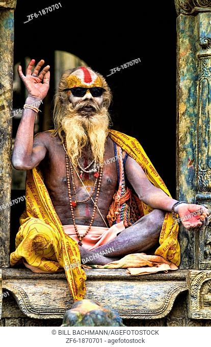 Kathmandu Nepal religious man who is a character painted in costume near river at famous Pashupatinath holi Hindu place on Bagmati River
