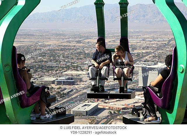 Tourists enjoy an attraction in the Stratosphere, Las Vegas, Nevada, USA