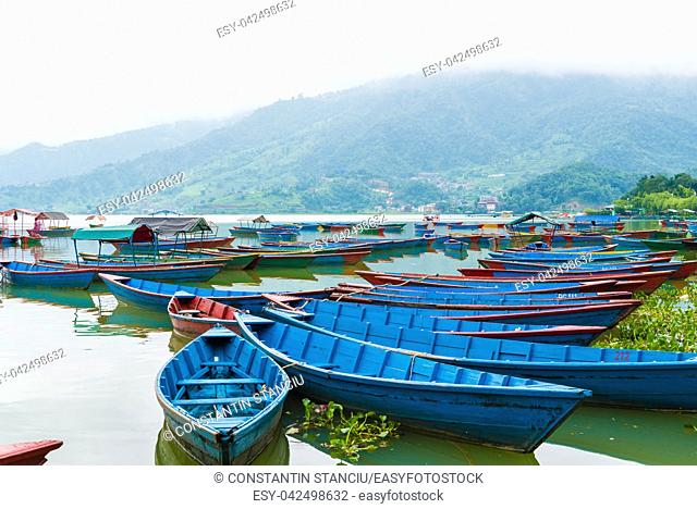 Pokhara, Nepal: Colourful boats on Phewa lake in Pokhara, the most popular and visited lake of Nepal
