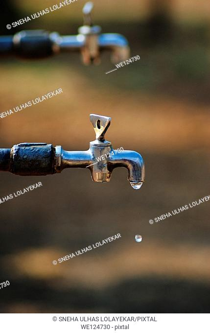 Water dripping from a tap,Poona, Maharashtra, India