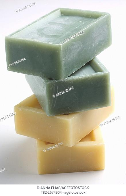 stack of four pills natural soap