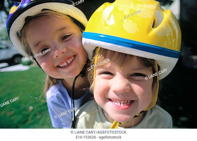 Friends together wearing bicycle helmets