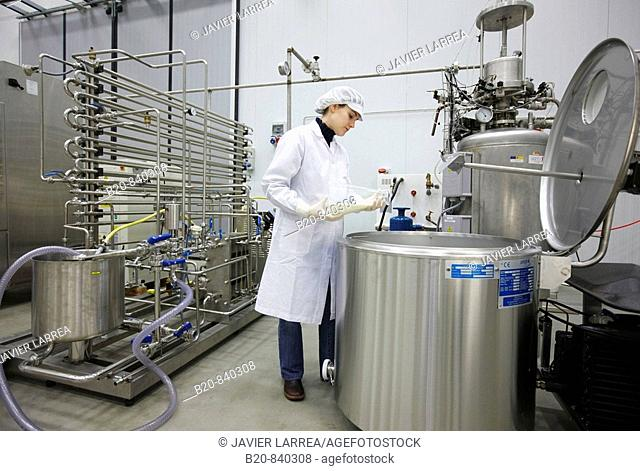 Researcher pasteurizating milk, pilot plant, AZTI-Tecnalia, Technology Centre for Marine and Food Research, Derio, Biscay, Basque Country, Spain