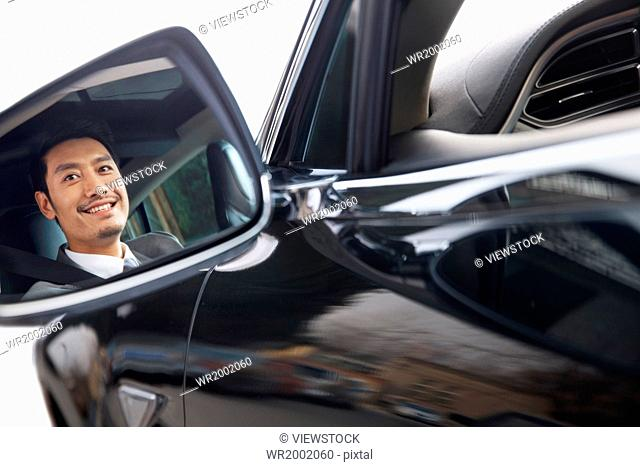 Businessman driving in car