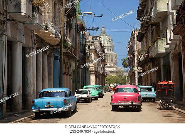 Old American cars used as taxi near the Capitolio building in Central Havana, Cuba, West Indies, Central America