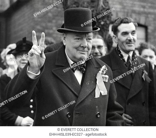 Conservative Party Leader Winston Churchill gives his familiar victory sign. He was making a last-minute campaign tour before the General Election