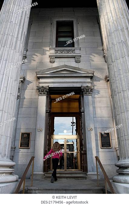 A Customer Walking Up The Steps To The Bank Of Montreal, Montreal Quebec Canada
