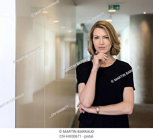 Portrait confident businesswoman in office corridor