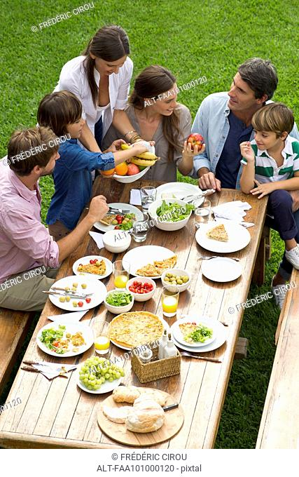 Family and friends gather for weekend picnic