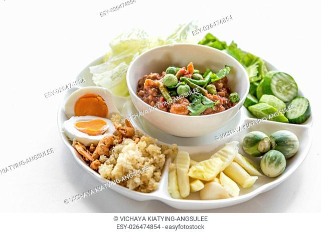 Thai chili paste with fresh vegetables on white background