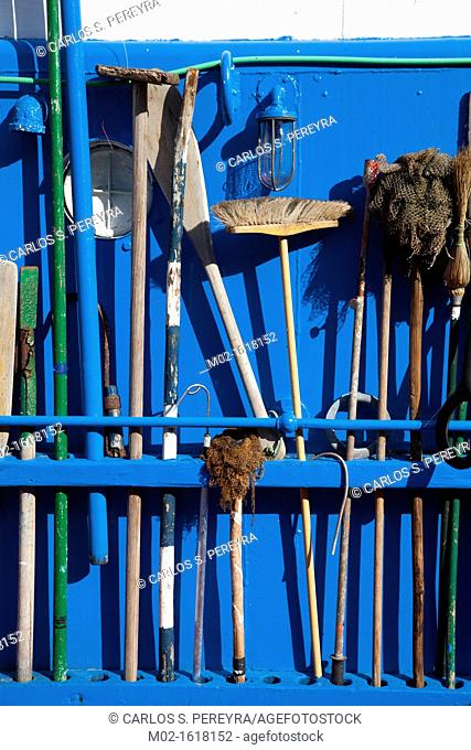 utensils for cleaning a boat in Basque Country, Spain