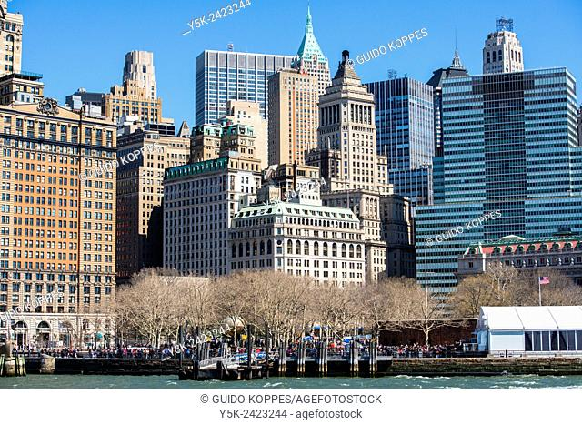 New York, USA. Daytime view on Battery Park and the Skyline of down town Manhattan from a ferry on the East River