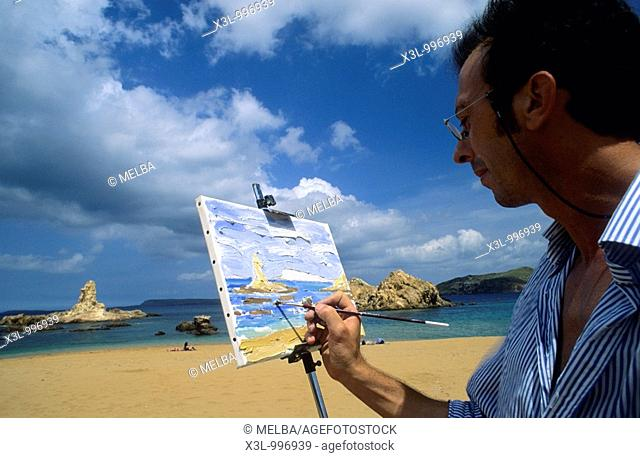 Painter in beach or cala Pregonda  Minorca  Balearis islands  Spain