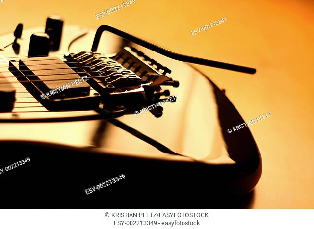 Details of a black electric guitar with copy-space