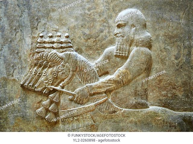Stone relief sculptured panel of Horse Driver. Facade L. Inv AO 19883 from Dur Sharrukin the palace of Assyrian king Sargon II at Khorsabad, 713-706 BC