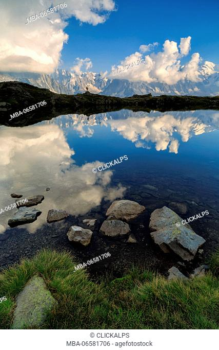 the gran jorasses mirrored on lake of Cheserys, chamonix, france, europe