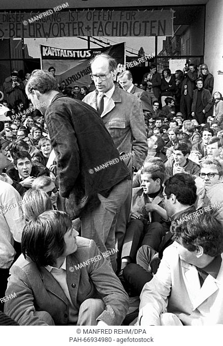 Prof. Walter Rüegg, head of university, leaves the building through the blocked main entrance during a sit-in of students as a protest against the state of...