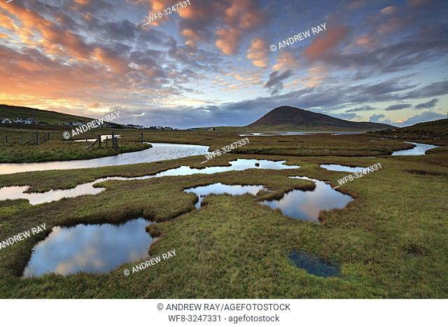 Sunset captured from Northton Salt Marsh on the Isle of Harris in early November. A long shutter speed was utilised to flatten the ripples on the surface of the...