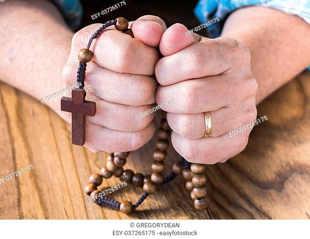 Woman with Rosary Beads in Her Hands