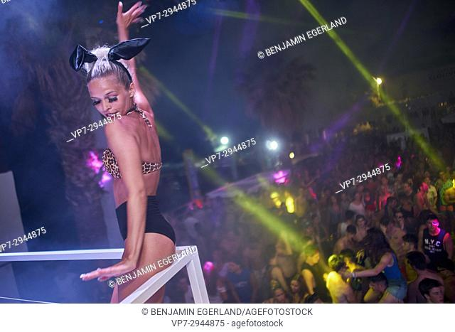 dancer performing at electronic music festival. Estonian ethnicity. During working holiday at Starbeach in Hersonissos, Crete, Greece