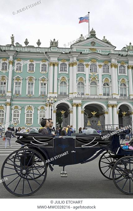 Tourists on a carriage by the Hermitage museum, St.Petersburg,Russia
