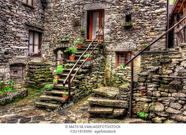 Rustic house in stone with stairs