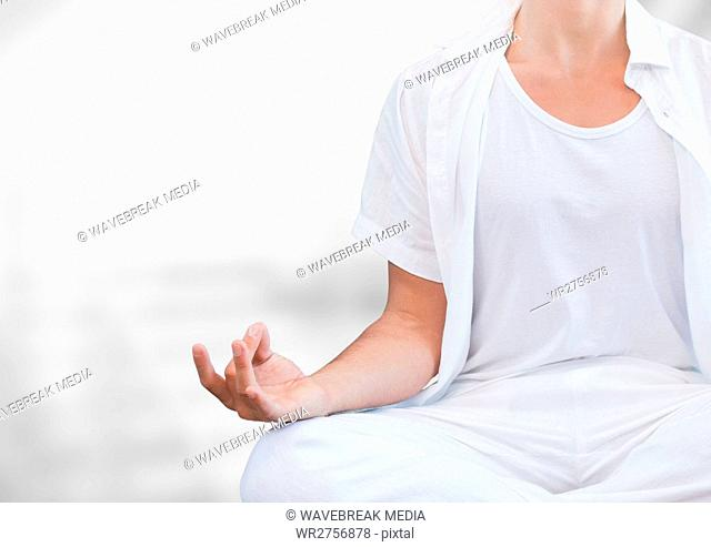 Womans hand Meditating with bright background